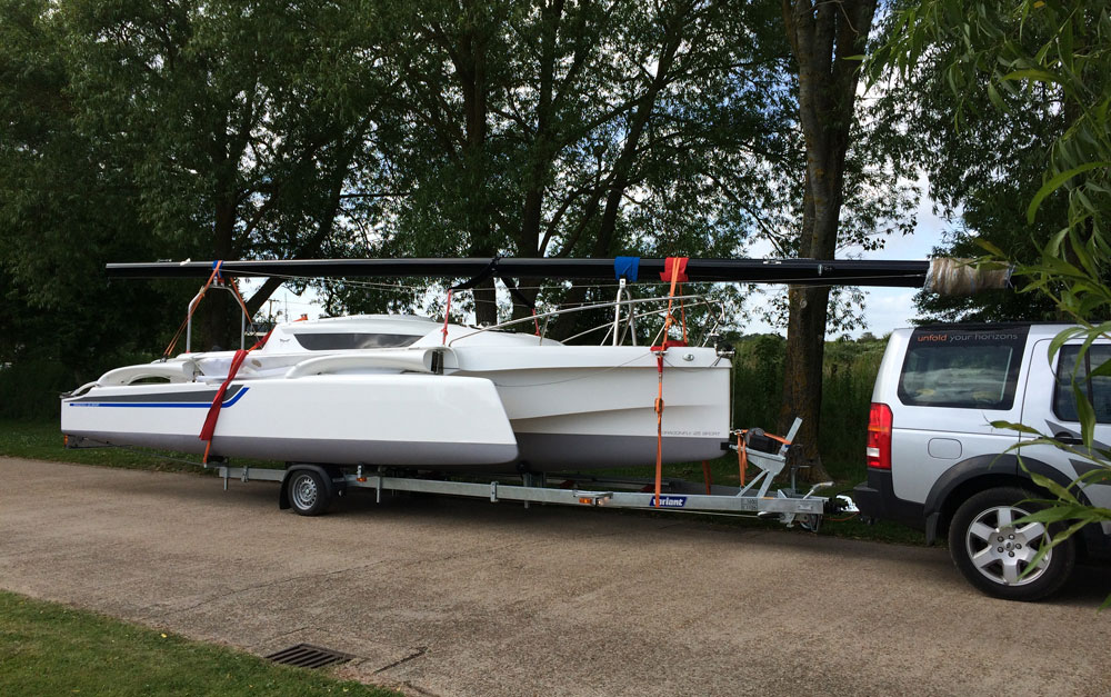 Dragonfly 25 trimaran on road trailer