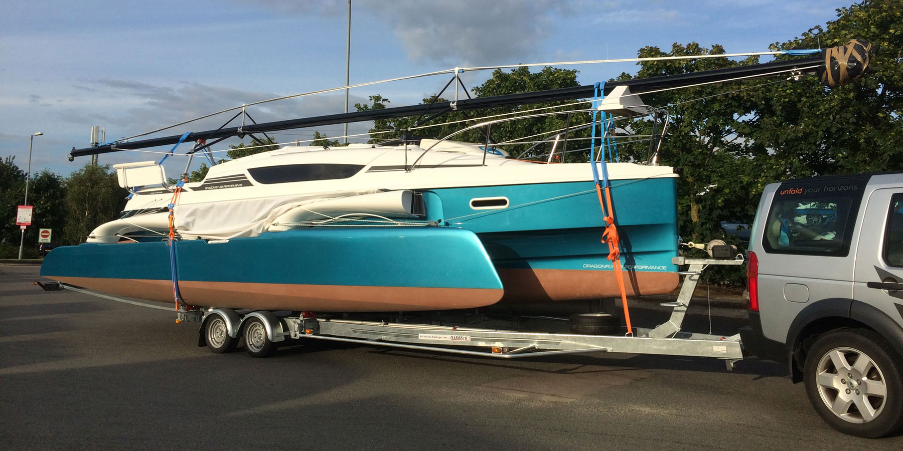 Dragonfly 28 trimaran on road trailer