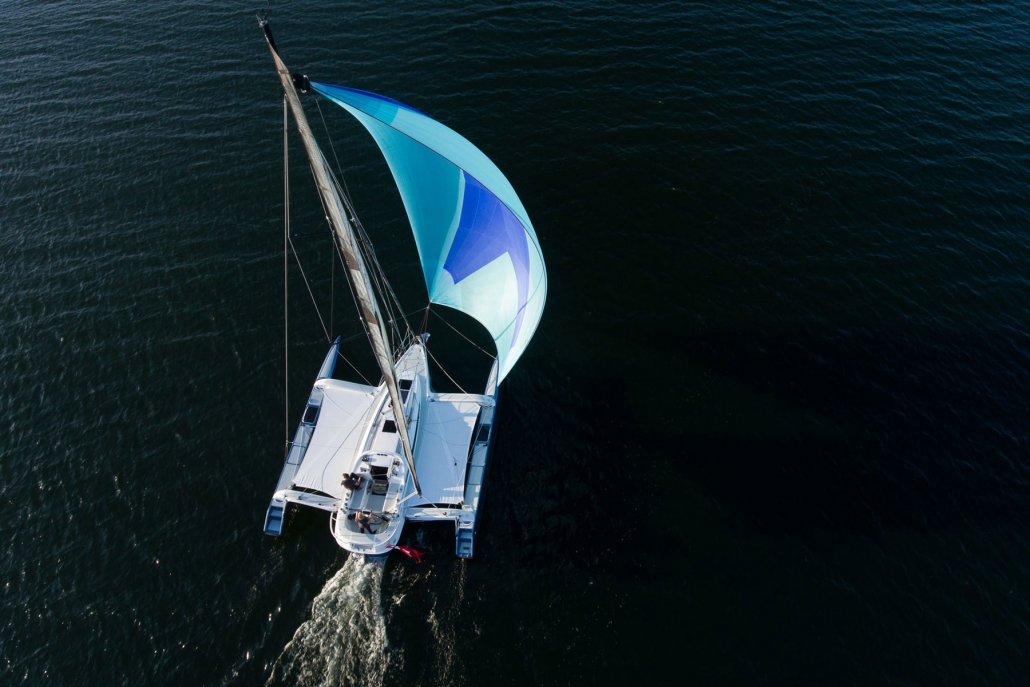 Dragonfly 32 trimaran with spinnaker overhead