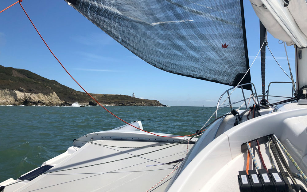 Dragonfly 28 trimaran approaching St Cats, RORC Race the Wight